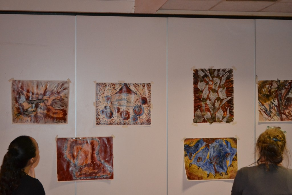 Contemplating on the paintings and sharing experiences